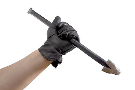incursion: Un coup de main dans les gants de cuir noir tenant une barre de vache Banque d'images