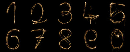 Numbers from 0 to 9 written with a sparkler isolated on black background