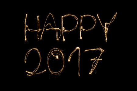 sparkler: Happy 2017 written with a sparkler isolated on black background Stock Photo