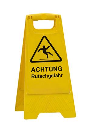 Yellow Achtung Rutschgefahr (German Caution slippery wet floor) sign isolated on white background
