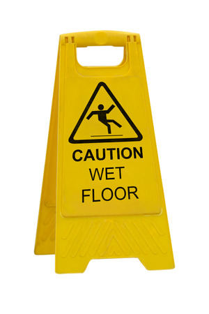 warning signs: Yellow Caution slippery wet floor sign isolated on white background