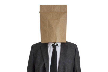 anonym: A Man in suit with a paper bag on his head isolated on white background