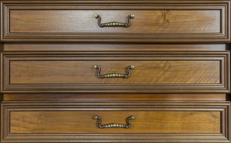 antique furniture: three drawers of an antique look-alike furniture
