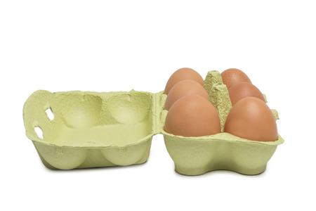 carton: Open Box with six brown eggs isolated on white background Stock Photo