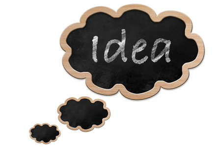 Idea written on a Blackboard in thought bubble shape with wooden frame, isolated on white backround photo