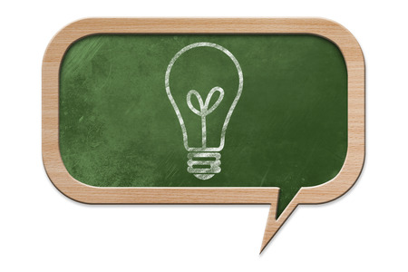 Light Bulb drawn on a Blackboard in speech bubble shape with wooden frame, isolated on white backround photo