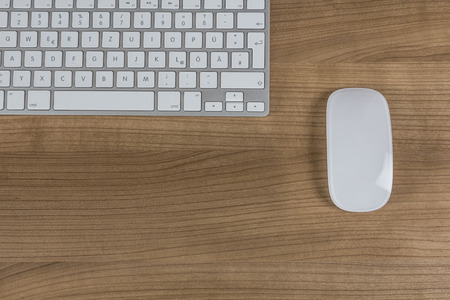 lifestile: Modern keyboard and mouse a on a wooden Desktop