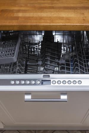 modern Half open empty dishwasher in a modern kitchen Stock Photo