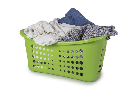messy clothes: Green Laundry Basket filled with clothes isolated on white background Stock Photo