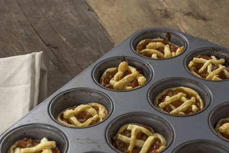 Mini apple pies in a muffin tray