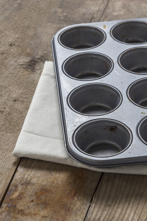 Muffin baking tray on a rustic wooden table photo