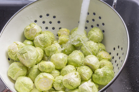 Washing Brussels sprouts in a sieve