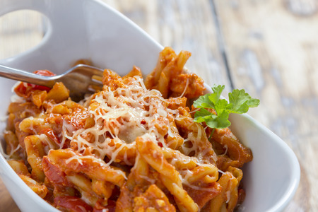 chese: Pasta with bolognese and cheese in a modern white bowl