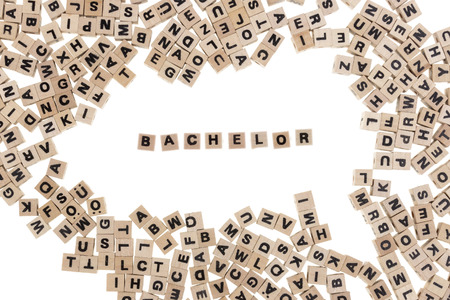 undergraduate: bachelor framed by small wooden cubes with letters isolated on white background