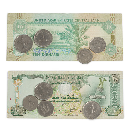 dirham: Ten Dirham Note and Coins, Currency of the United Arab Emirates on wooden table Stock Photo