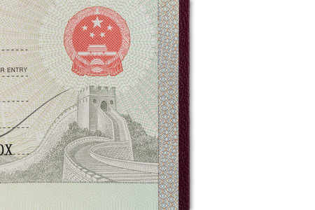foreign nation: Detail view of chinese visa in a passport isolated on white background Stock Photo