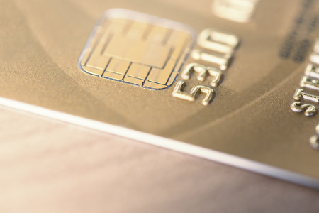 cloesup: Cloesup view of a golden credit card on a wooden table Stock Photo