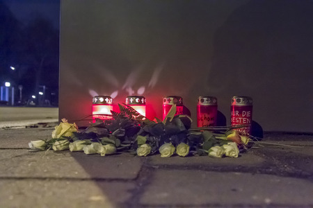 dolor: Candles and Flowers on a sidewalk after a fatal car accident