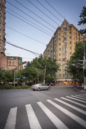fench: SHANGHAI- JUNE 5: Street scene, intersection with zebra crossing and car in fench consession district on June 5, 2015 in Shanghai Editorial