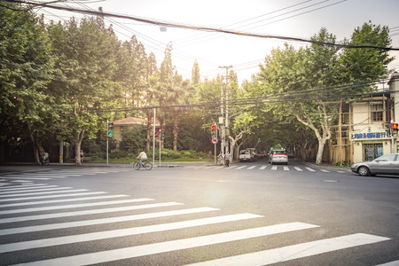 fench: SHANGHAI- JUNE 5: Street scene, intersection of an alley road in fench consession district on June 5, 2015 in Shanghai Editorial