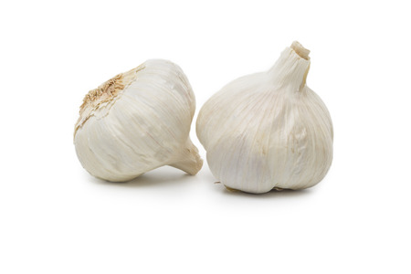 skinning: Two Garlic bulbs isolated on white background