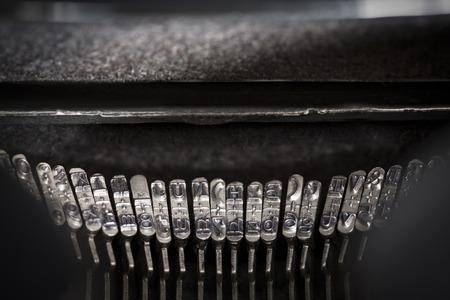 typebar: Detail view of typebars in a typewriter