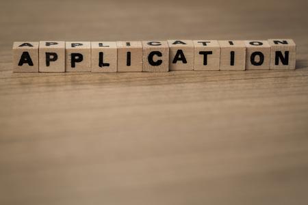 employe: Application written in wooden cubes on a desk Stock Photo