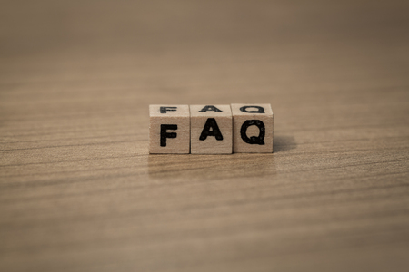 frequent: faq written in wooden cubes on a desk Stock Photo