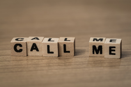 call me: Call me written in wooden cubes on a desk Stock Photo