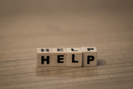 frequent: Help written in wooden cubes on a desk Stock Photo