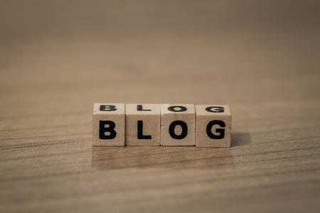 follower: Blog written in wooden cubes on a desk