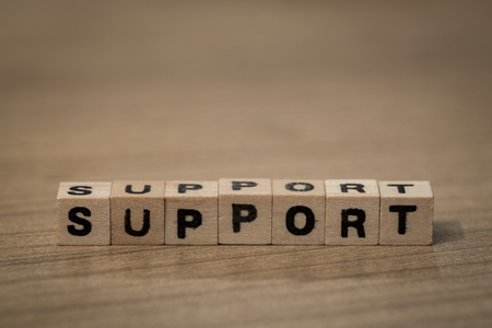 frequent: Support written in wooden cubes on a desk Stock Photo