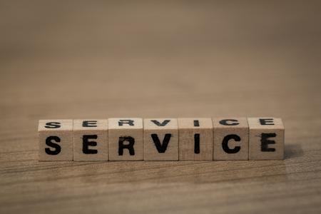 service desk: Service, written in wooden cubes on a desk