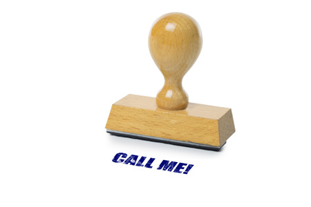 rubberstamp: Call Me printed in blue ink with wooden Rubber stamp isolated on white background