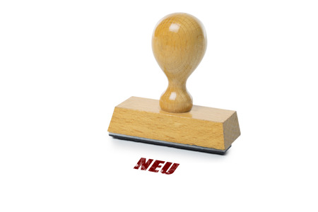 rubberstamp: Neu (german New) printed in red ink with wooden Rubber stamp isolated on white background