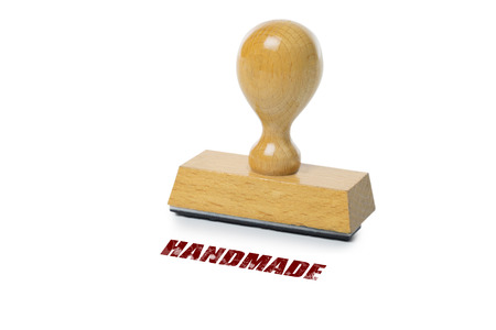 rubberstamp: Handmade printed in red ink with wooden Rubber stamp isolated on white background