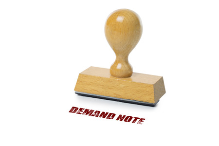 rubberstamp: Demand Note printed in red ink with wooden Rubber stamp isolated on white background