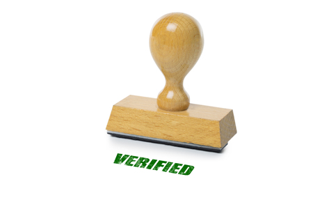 rubberstamp: Verified printed in green ink with wooden Rubber stamp isolated on white background