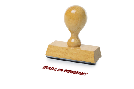 rubberstamp: Made in Germany printed in red ink with wooden Rubber stamp isolated on white background