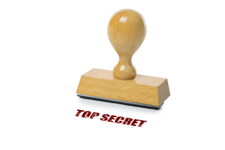 rubberstamp: Top Secret printed in red ink with wooden Rubber stamp isolated on white background