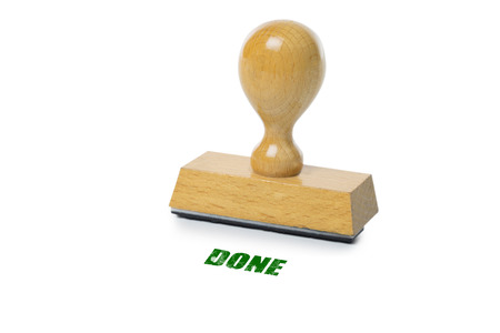 green ink: Done printed in green ink with wooden Rubber stamp isolated on white background Stock Photo