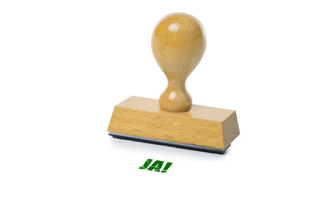 green ink: Ja (german Yes) printed in green ink with wooden Rubber stamp isolated on white background