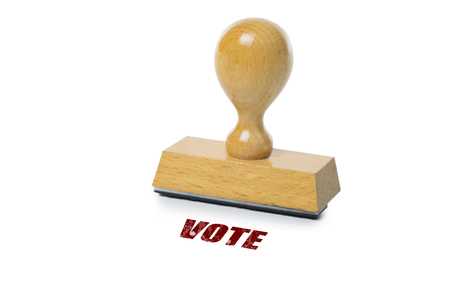 rubberstamp: Vote printed in red ink with wooden Rubber stamp isolated on white background Stock Photo