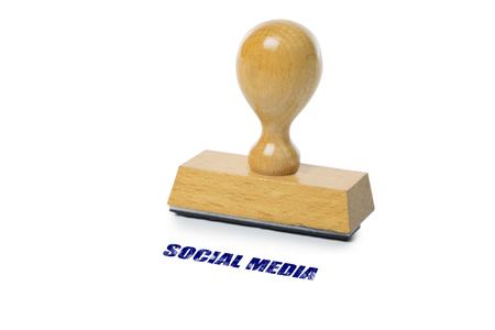 rubberstamp: Social Media printed in blue ink with wooden Rubber stamp isolated on white background