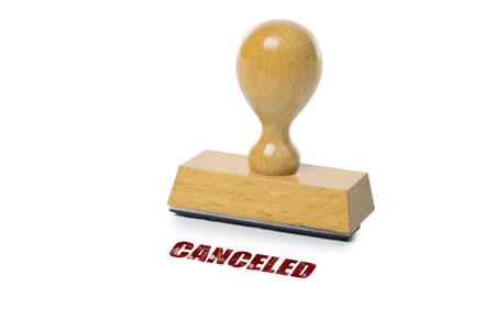 rubberstamp: Cancelled printed in red ink with wooden Rubber stamp isolated on white background
