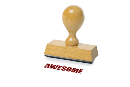rubberstamp: Awesome  printed in red ink with wooden Rubber stamp isolated on white background