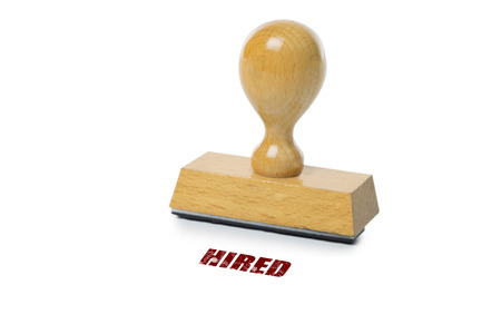 rubberstamp: Hired printed in red ink with wooden Rubber stamp isolated on white background