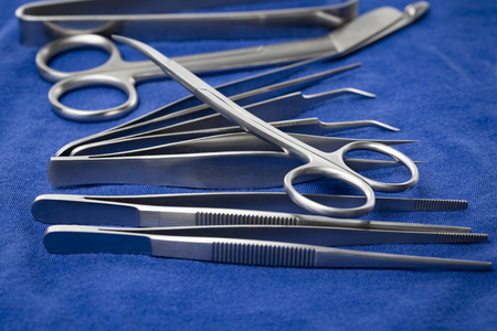 surgical tray: Detail of surgical instruments and tools on a tray covered with blue cloth Stock Photo