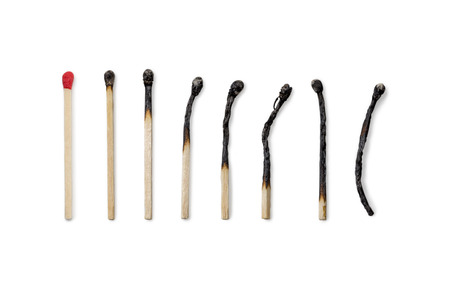 quemado: Row of Matches from new to completely burned isolated on white background Foto de archivo