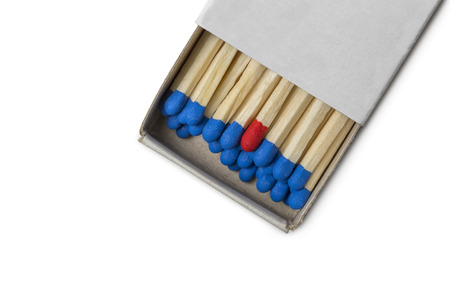 loner: Matchbox with blue and one red matches isolated on white background Stock Photo